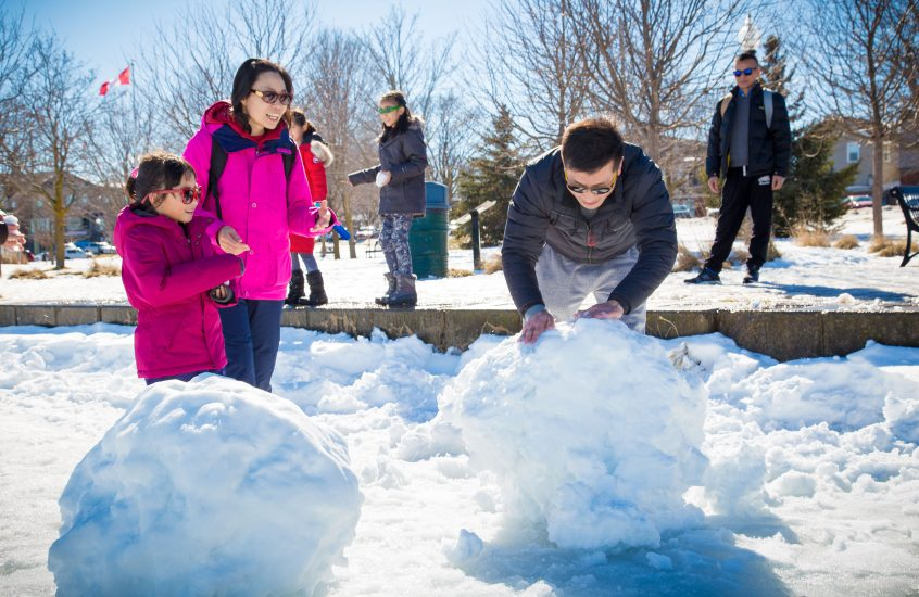 family making snowmen