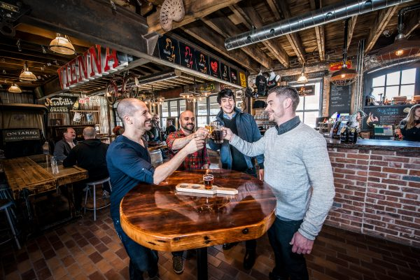 Men toasting at Old Flame Brewery