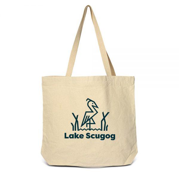 Cream coloured tote bag wtih Lake Scugog logo and a blue heron.